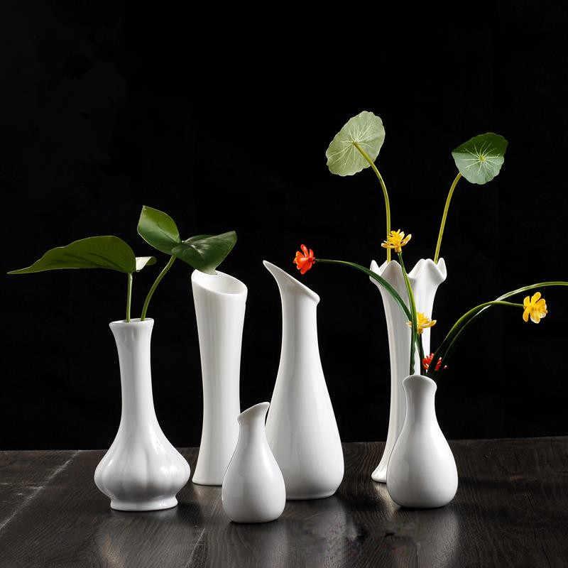 Interior decoration with white vases