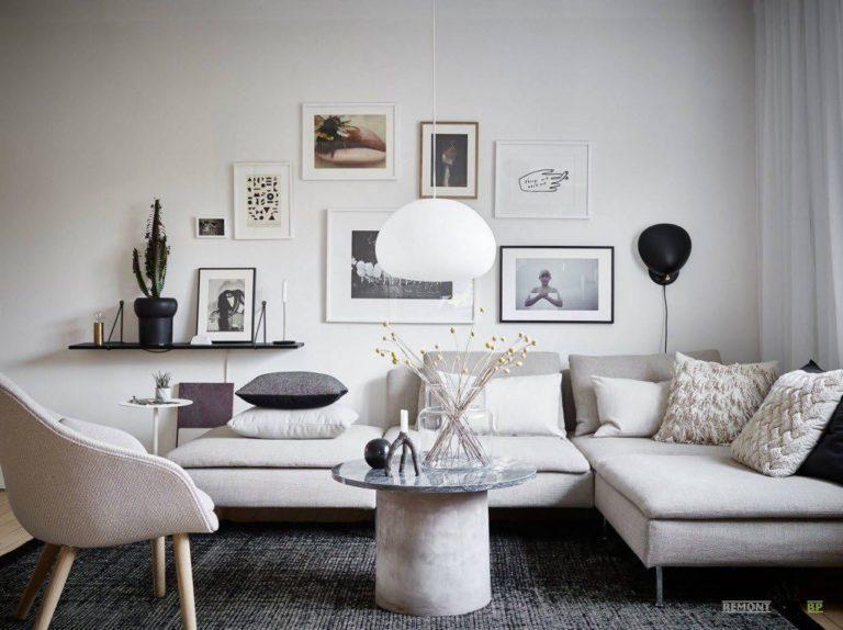 Soggiorno bianco e grigio: caratteristiche di design e decorazione