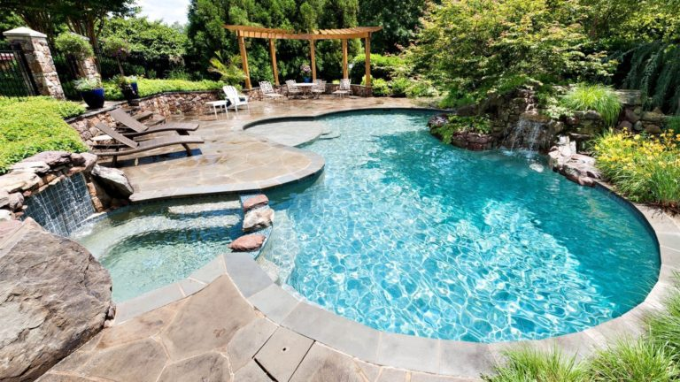 A stunning backyard solution - a pool with a waterfall will make you freeze with delight