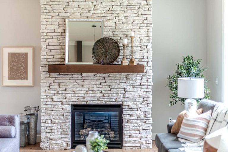 What is the recommended distance of the mantel from the floor and fireplace hearth
